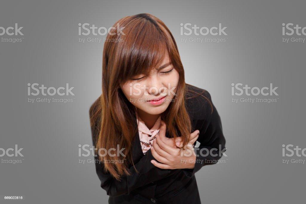 Businesswoman having heart attack - Angina Pectoris, Myocardial Infarction - office syndrome. stock photo
