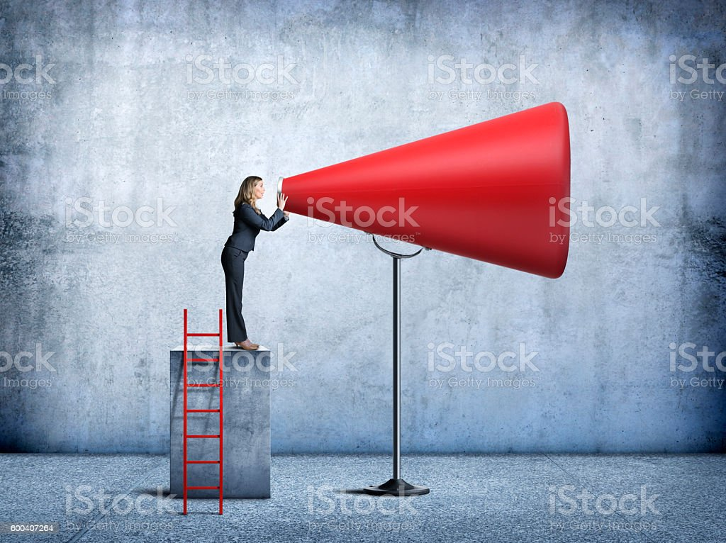 Businesswoman Having Her Voice Amplified stock photo