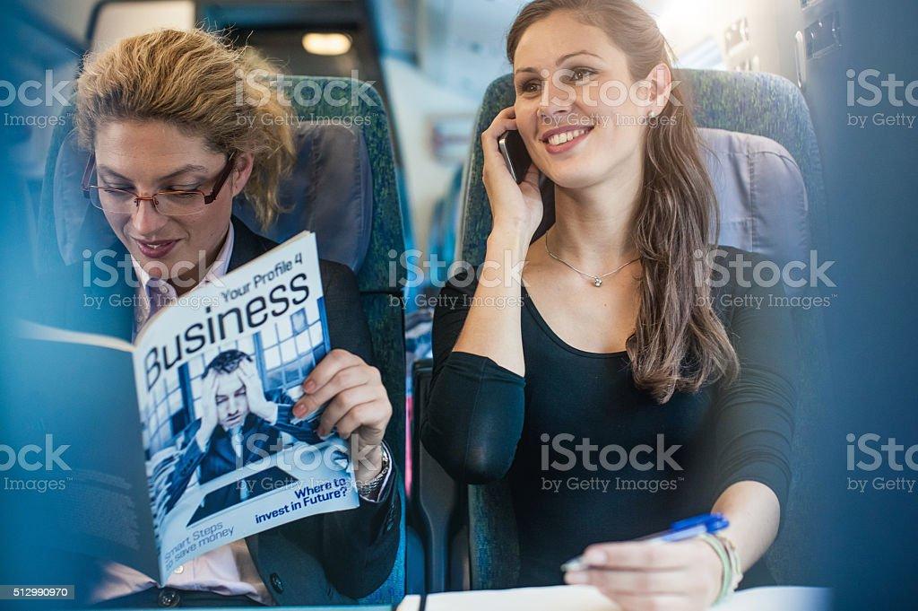 Businesswoman having meeting on the train stock photo
