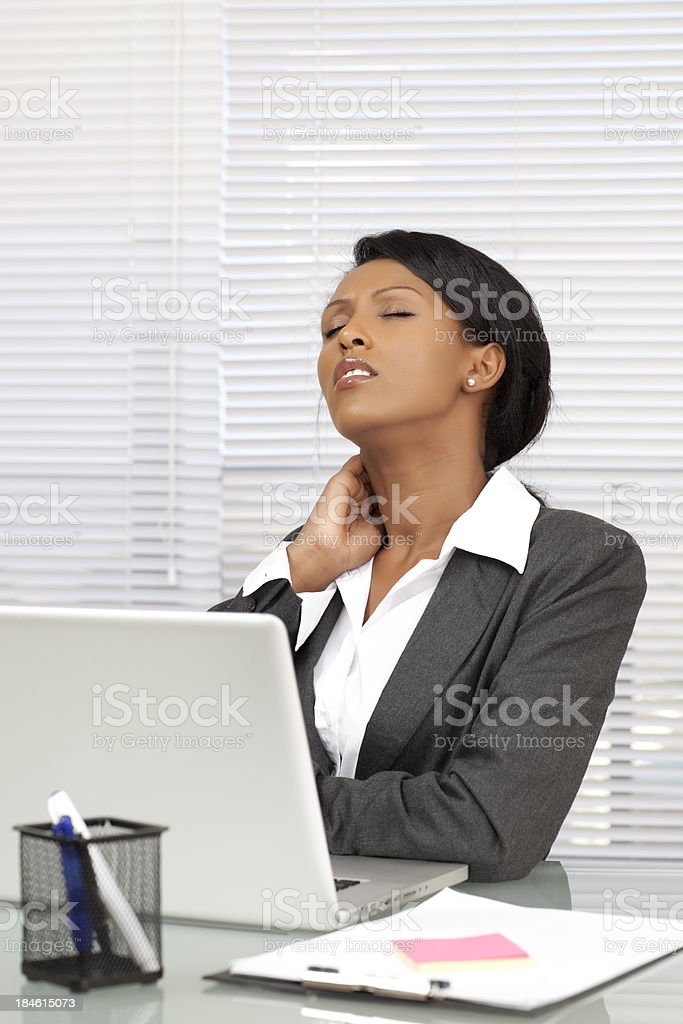 Businesswoman having neck pain. royalty-free stock photo