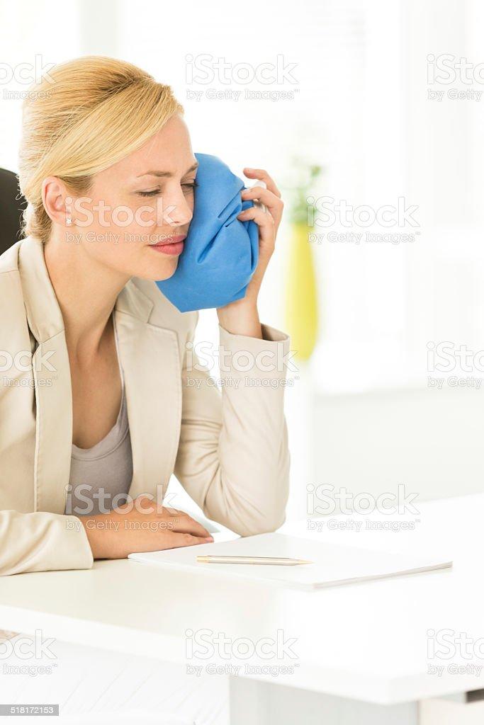 Businesswoman having toothache stock photo