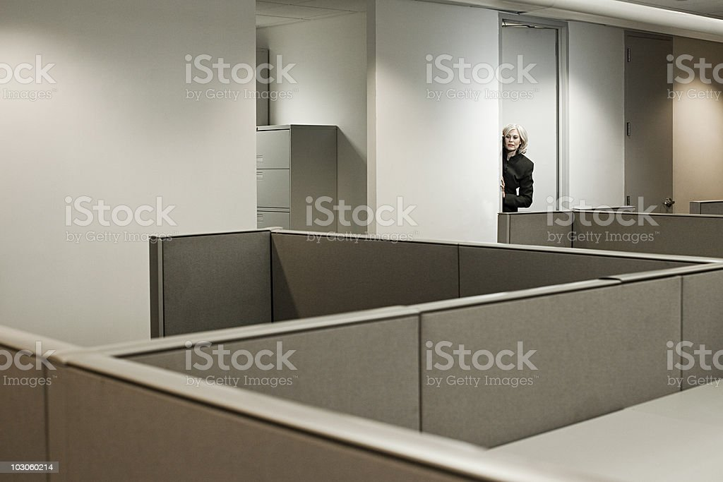 Businesswoman hiding in office stock photo
