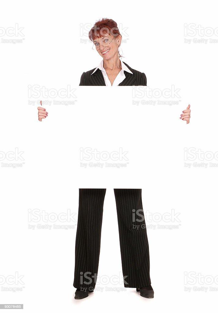 businesswoman holding a blank blackboard royalty-free stock photo