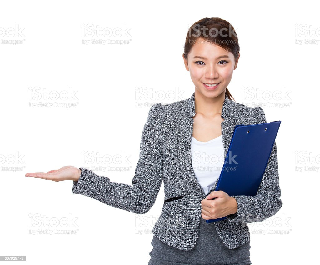 Businesswoman holding a clipboard and gesturing stock photo