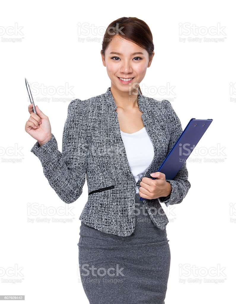 Businesswoman holding a clipboard and pen stock photo