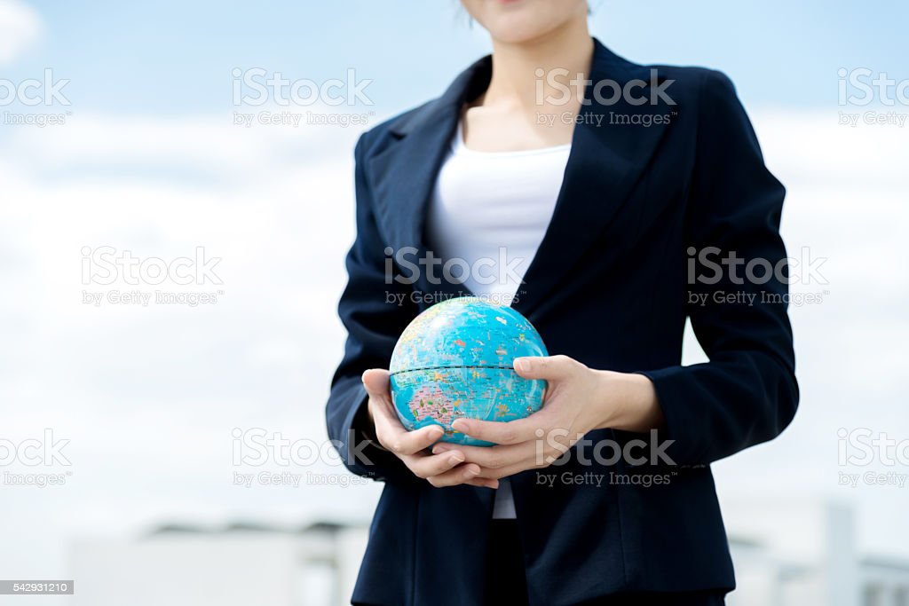 Businesswoman holding a globe stock photo