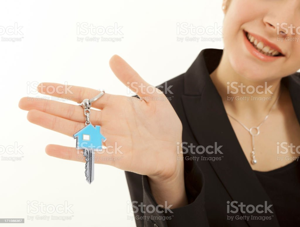 Businesswoman holding a House key. royalty-free stock photo