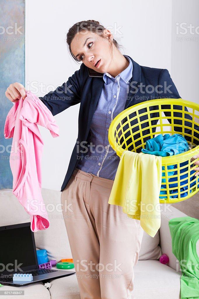Businesswoman holding a laundry basket stock photo