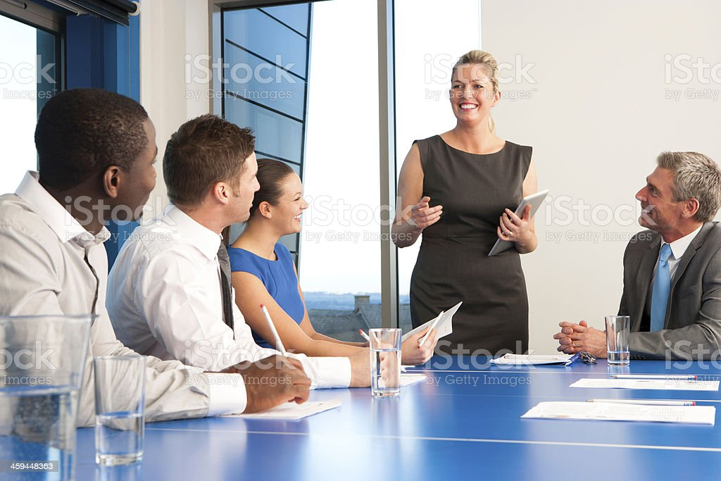 Businesswoman holding a meeting royalty-free stock photo