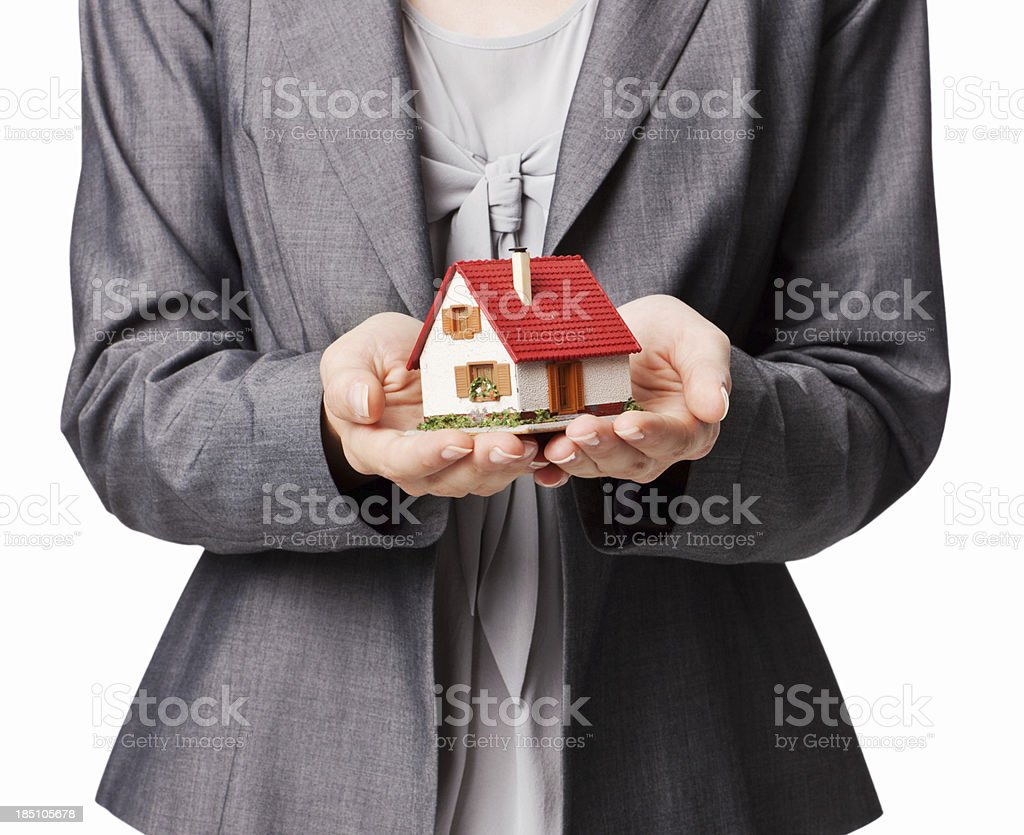 Businesswoman Holding a Model Home - Isolated royalty-free stock photo