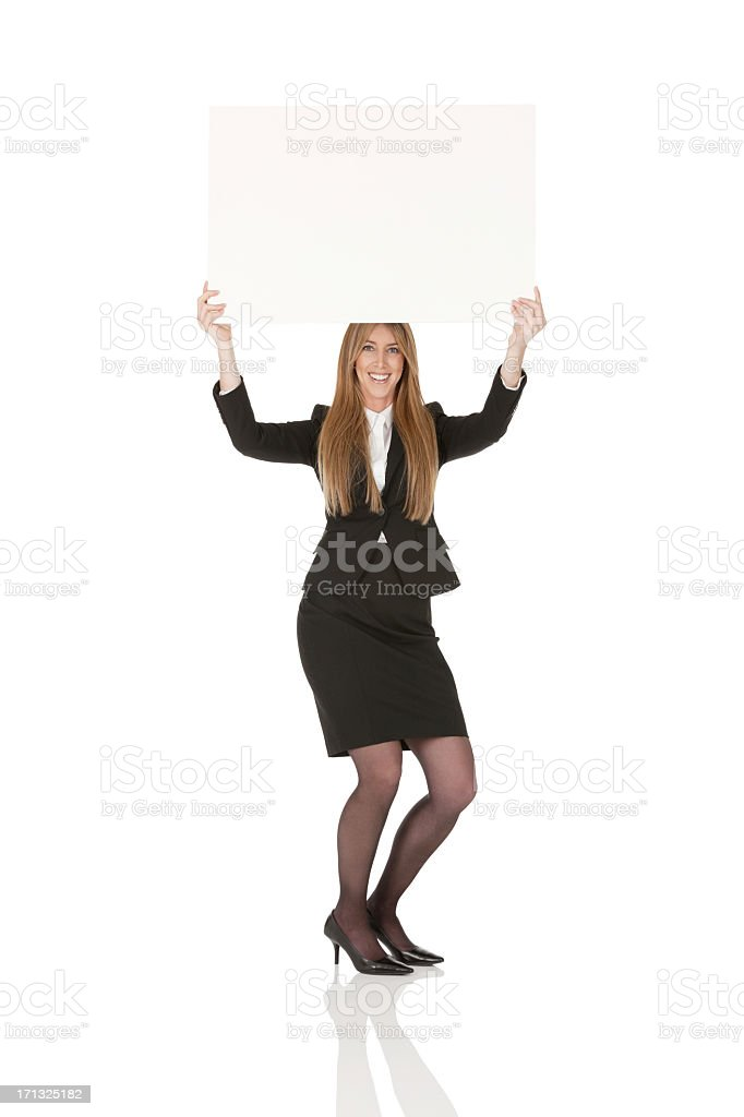 Businesswoman holding a placard stock photo
