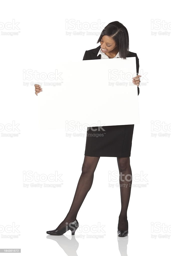 Businesswoman holding a placard royalty-free stock photo