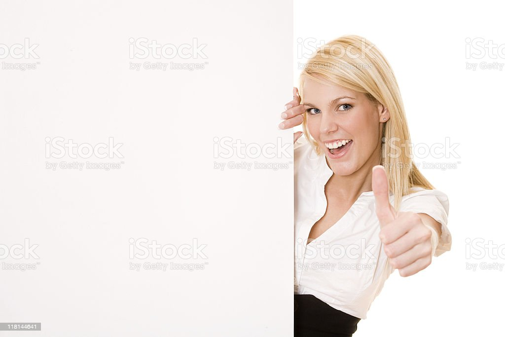 Businesswoman holding a placard with her thumb up royalty-free stock photo