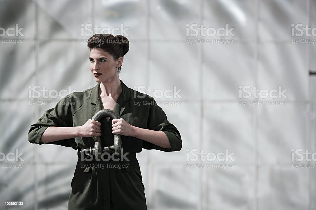 Businesswoman holding a shackle stock photo