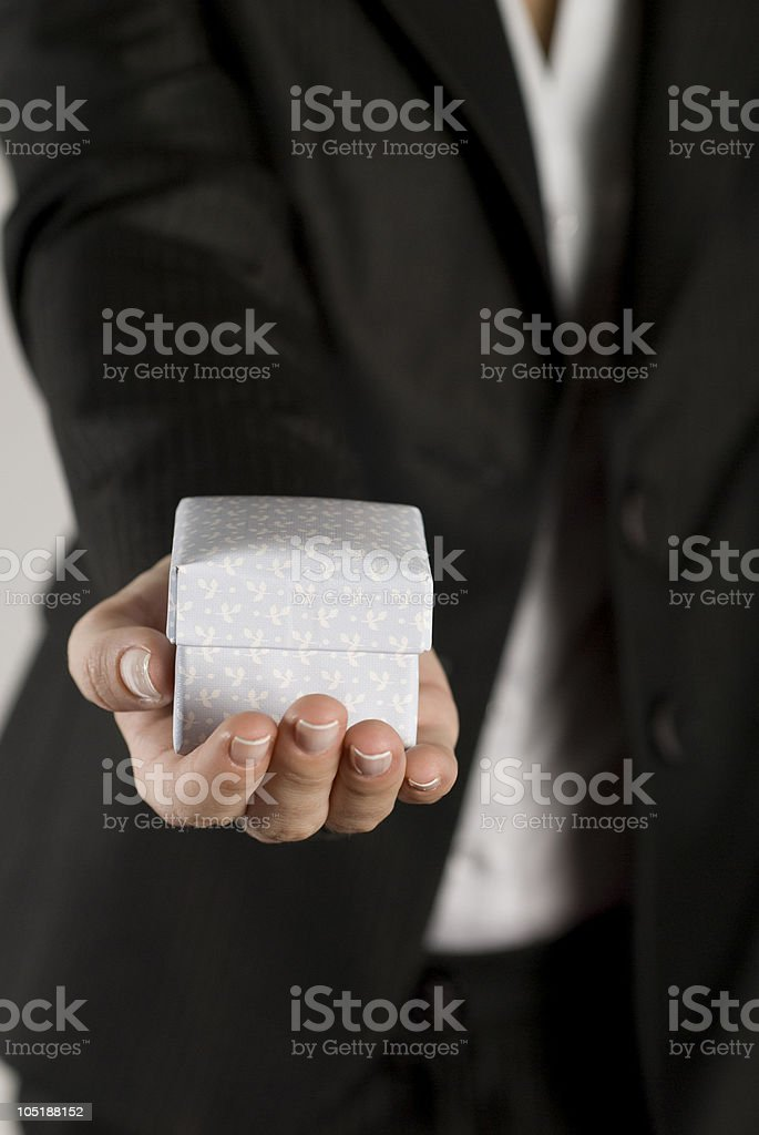 Businesswoman holding a small gift royalty-free stock photo