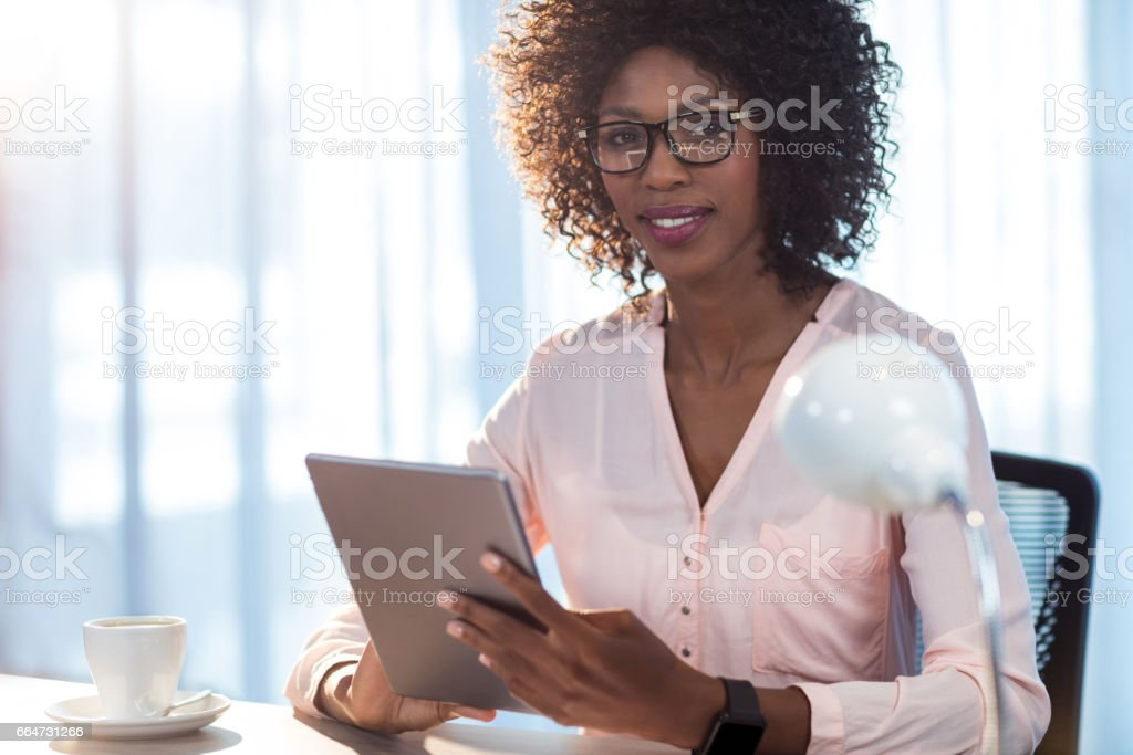 Businesswoman holding a tablet royalty-free stock photo