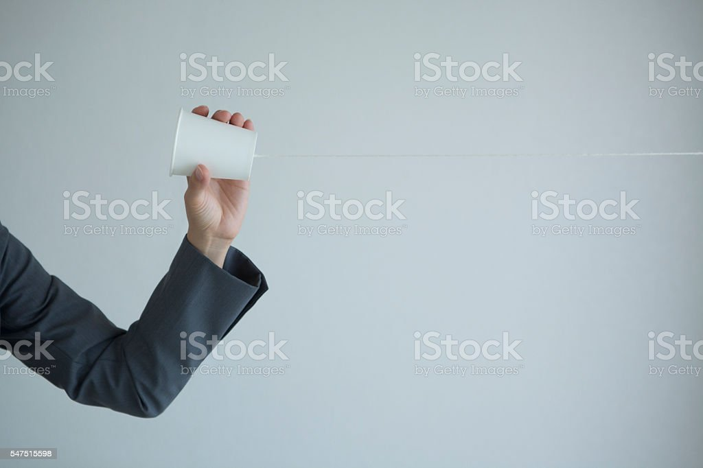 Businesswoman holding a telephone stock photo