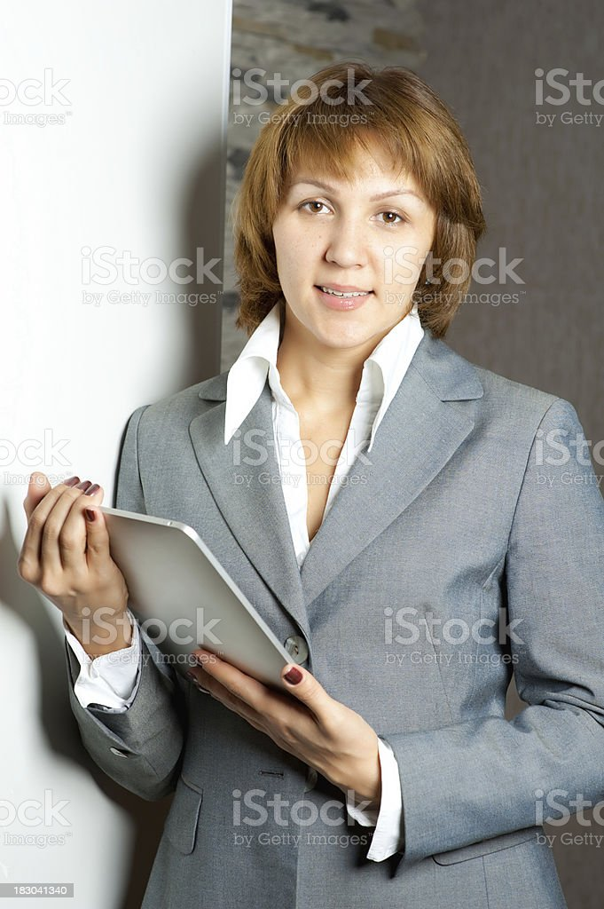 Businesswoman holding a touchpad pc royalty-free stock photo