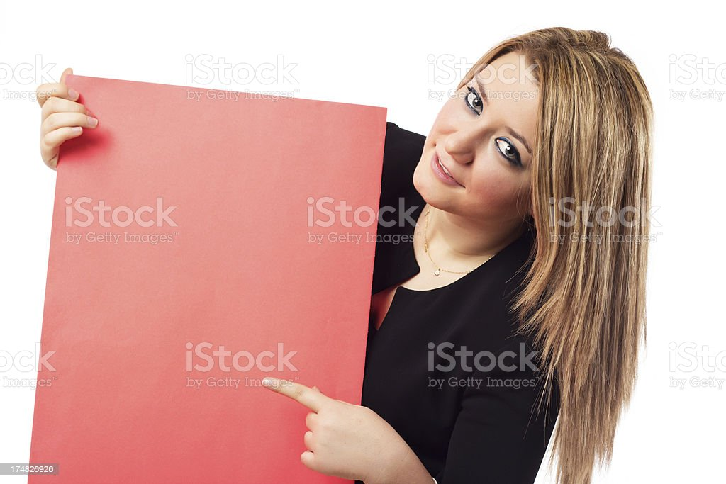 Businesswoman holding and showing a blank paper royalty-free stock photo
