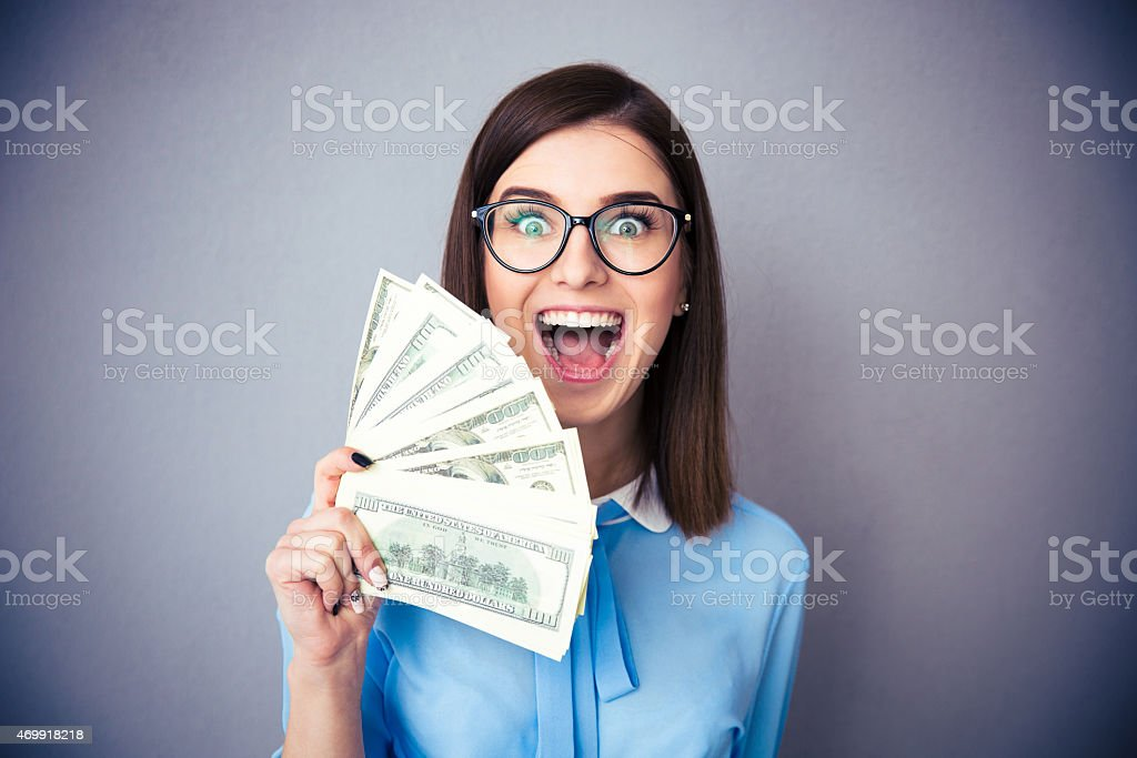Businesswoman holding bill of dollars and shouting stock photo