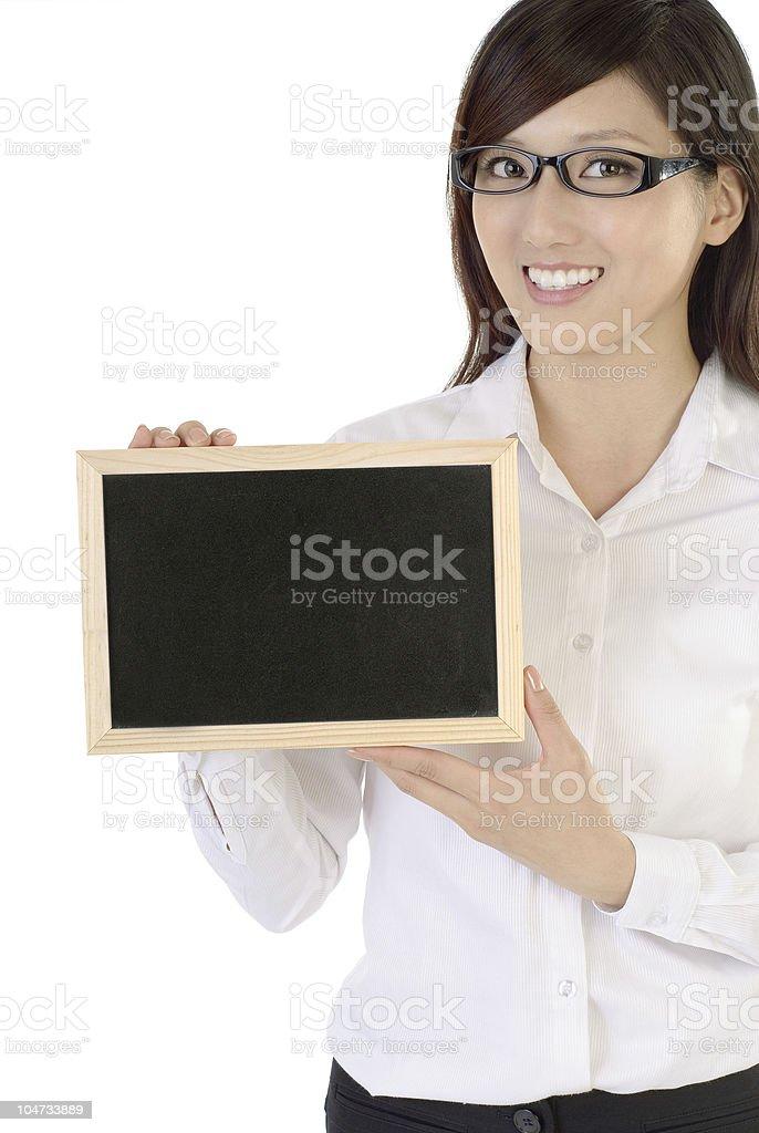 Businesswoman holding blackboard royalty-free stock photo