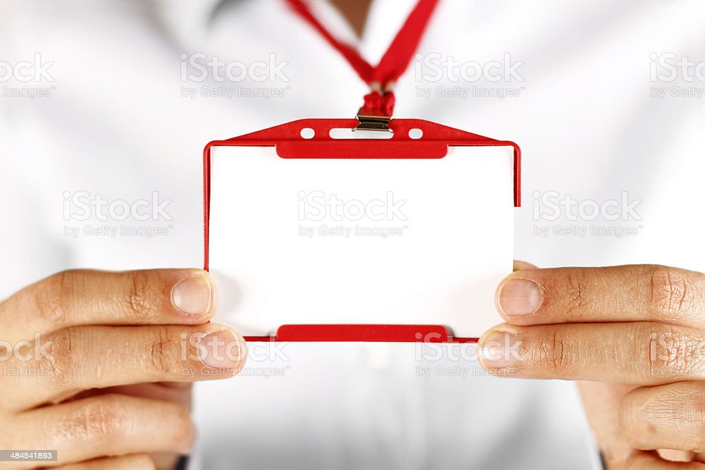 Businesswoman Holding Blank Identification Badge stock photo