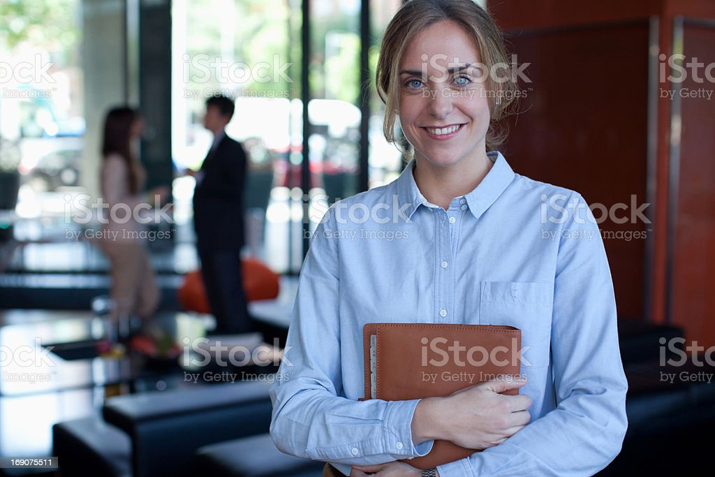 Businesswoman holding book in office royalty-free stock photo