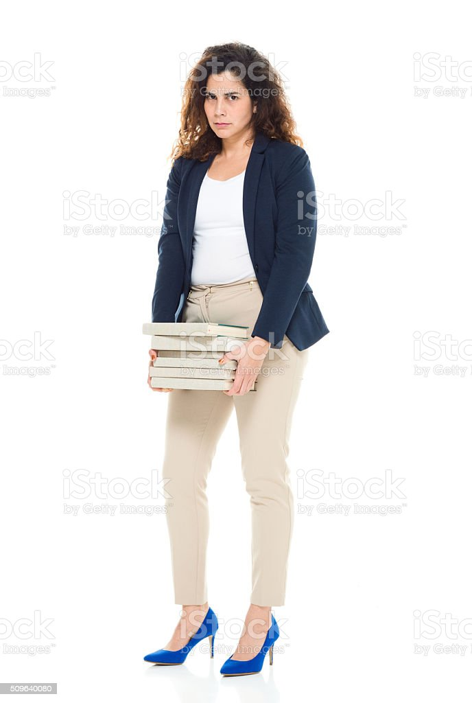 Businesswoman holding books stock photo