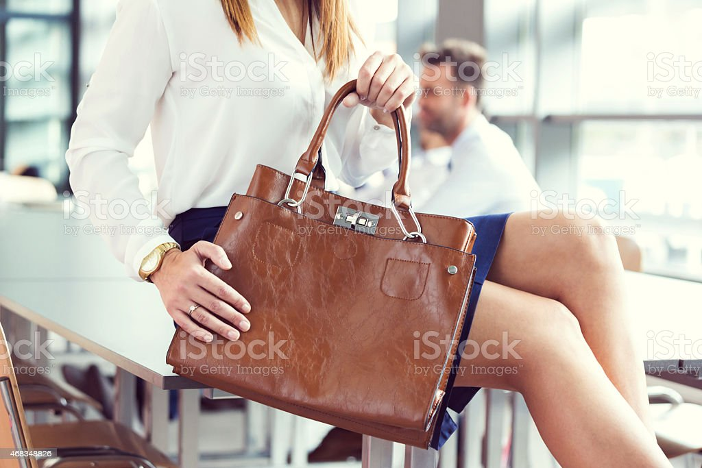 Businesswoman holding briefcase, close up stock photo