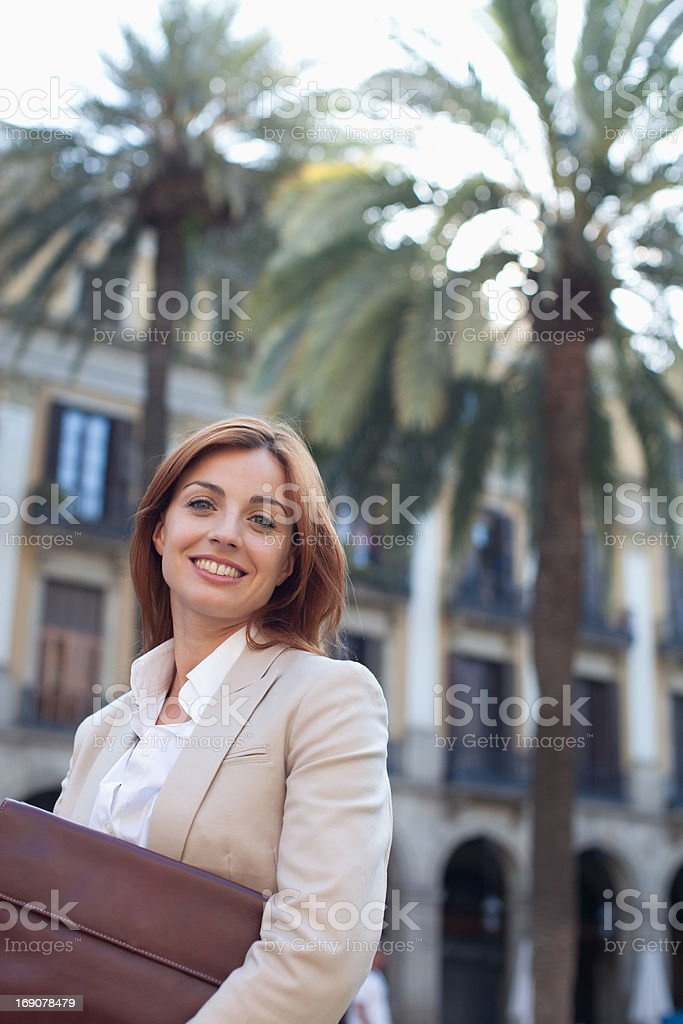 Businesswoman holding briefcase outdoors royalty-free stock photo