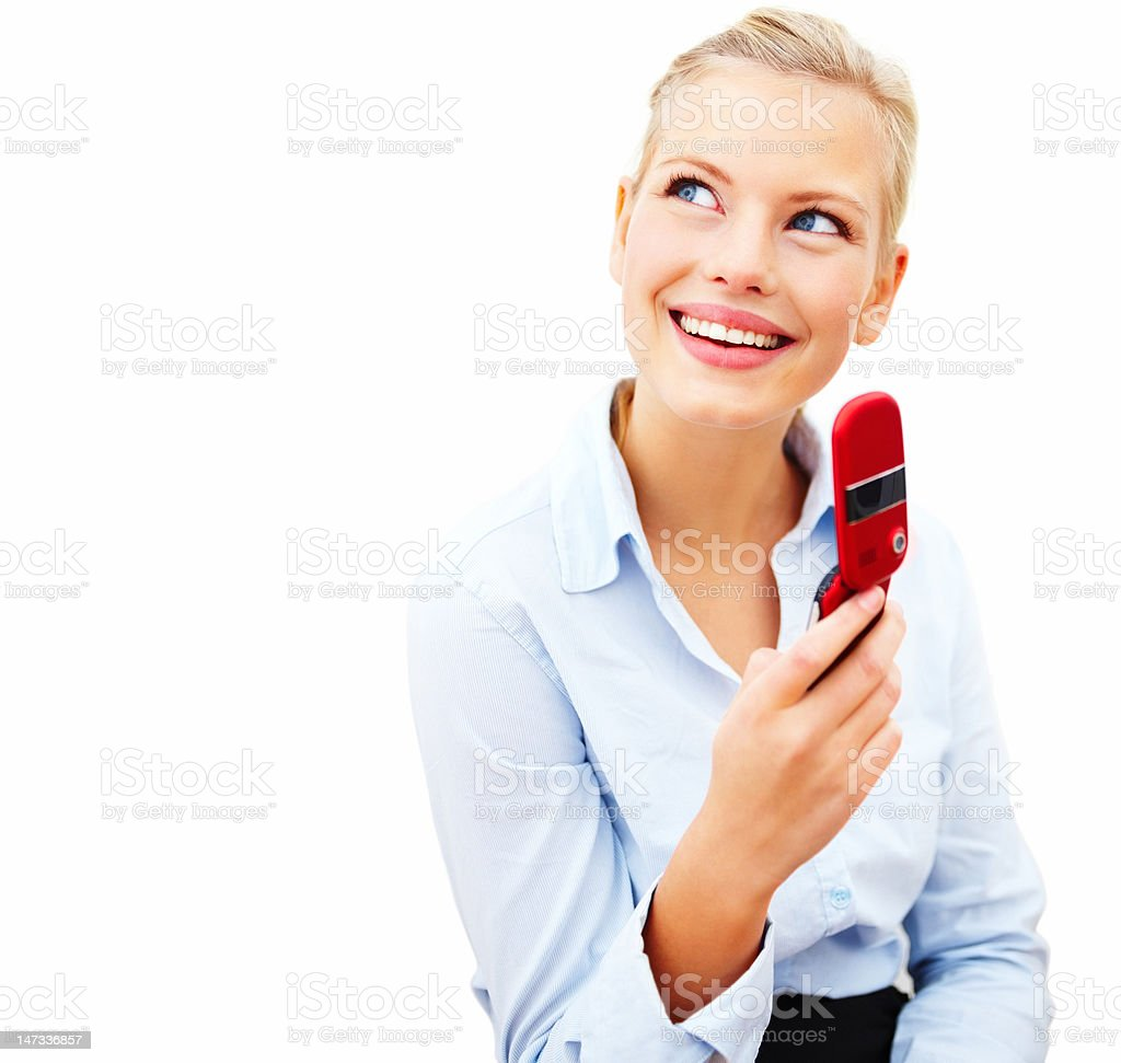 Businesswoman holding cellphone and smiling against white background royalty-free stock photo