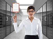 Businesswoman holding clipboard icon on virtual screen