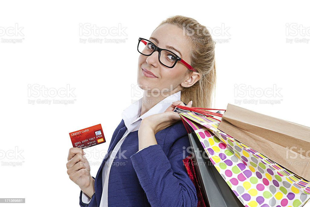 Businesswoman holding credit cards with shopping bags on white background royalty-free stock photo