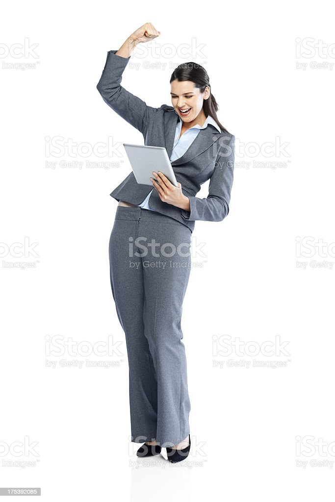 Businesswoman holding digital tablet expressing her success royalty-free stock photo