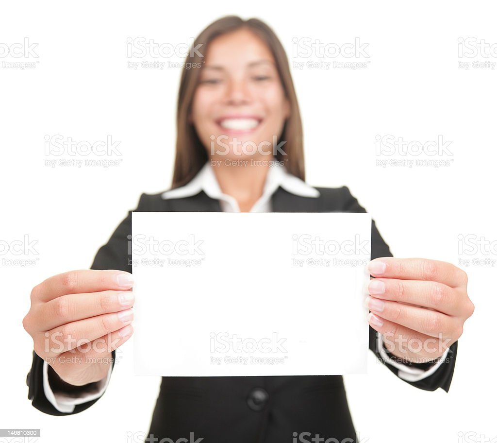 Businesswoman holding empty blank business sign card royalty-free stock photo