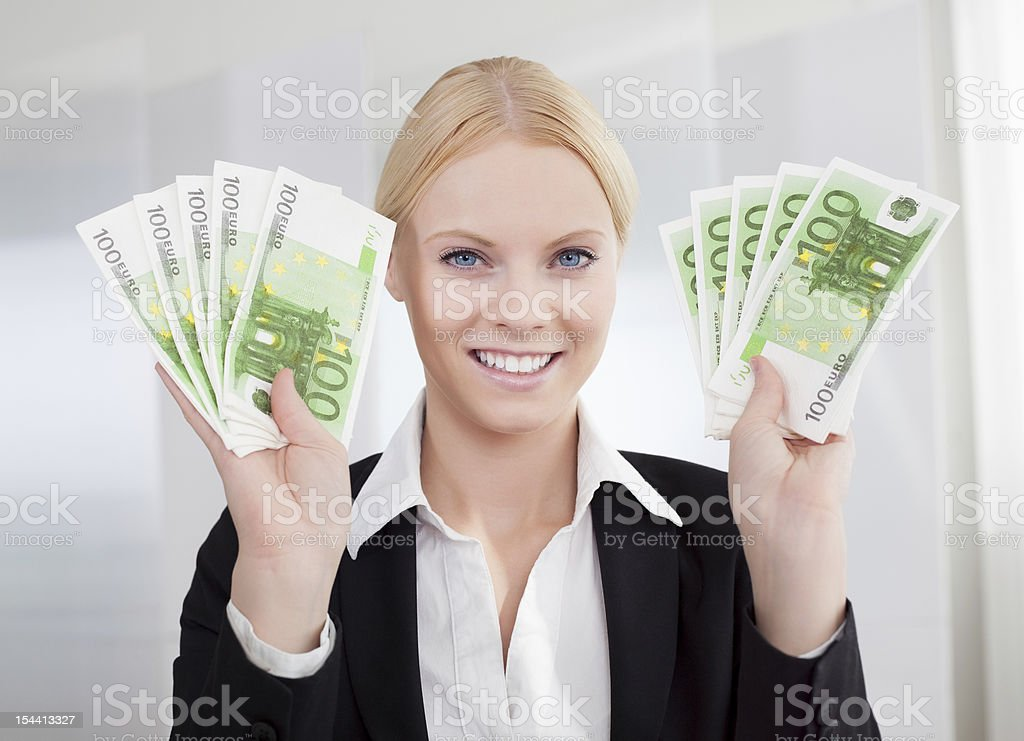 Businesswoman holding euro currency notes royalty-free stock photo
