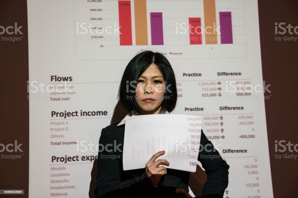 Businesswoman holding financial records in a projection stock photo