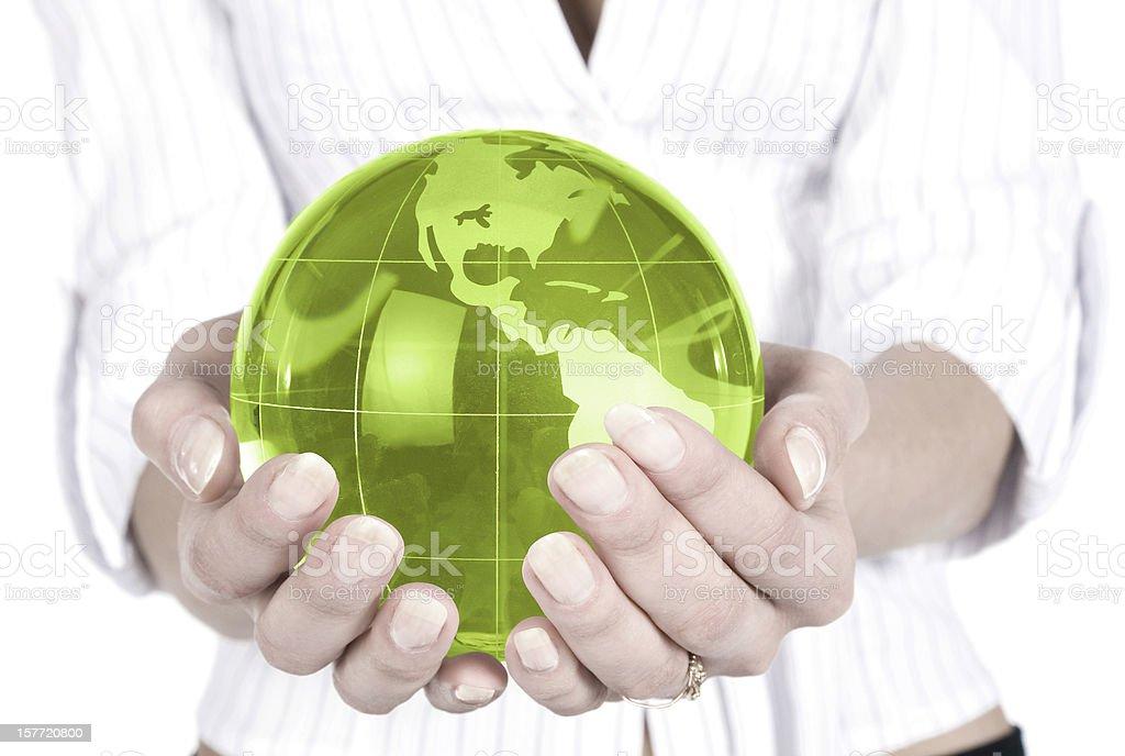 Businesswoman holding green globe royalty-free stock photo