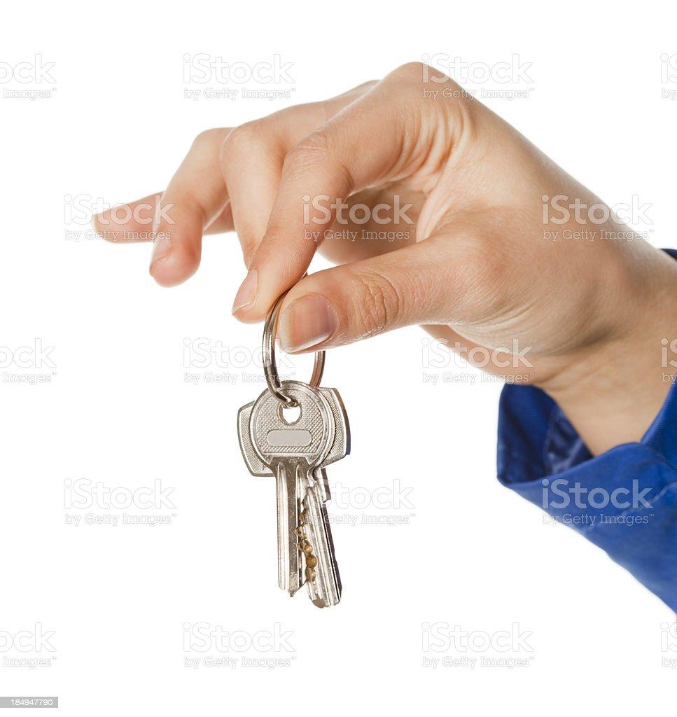 Businesswoman holding key stock photo