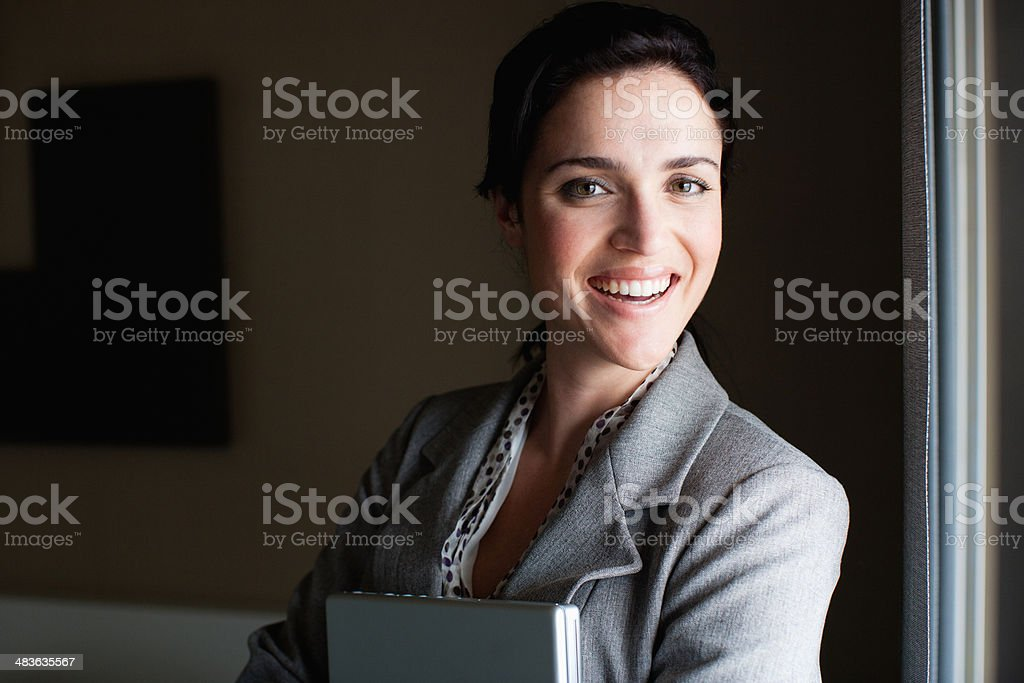 Businesswoman holding laptop stock photo