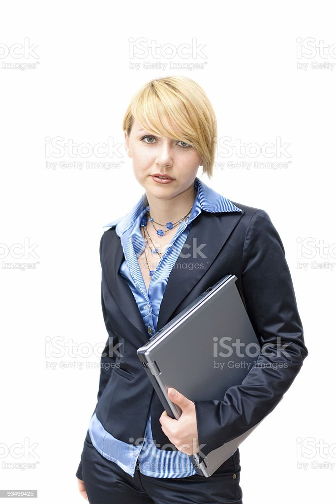 Businesswoman holding laptop under one's arm royalty-free stock photo