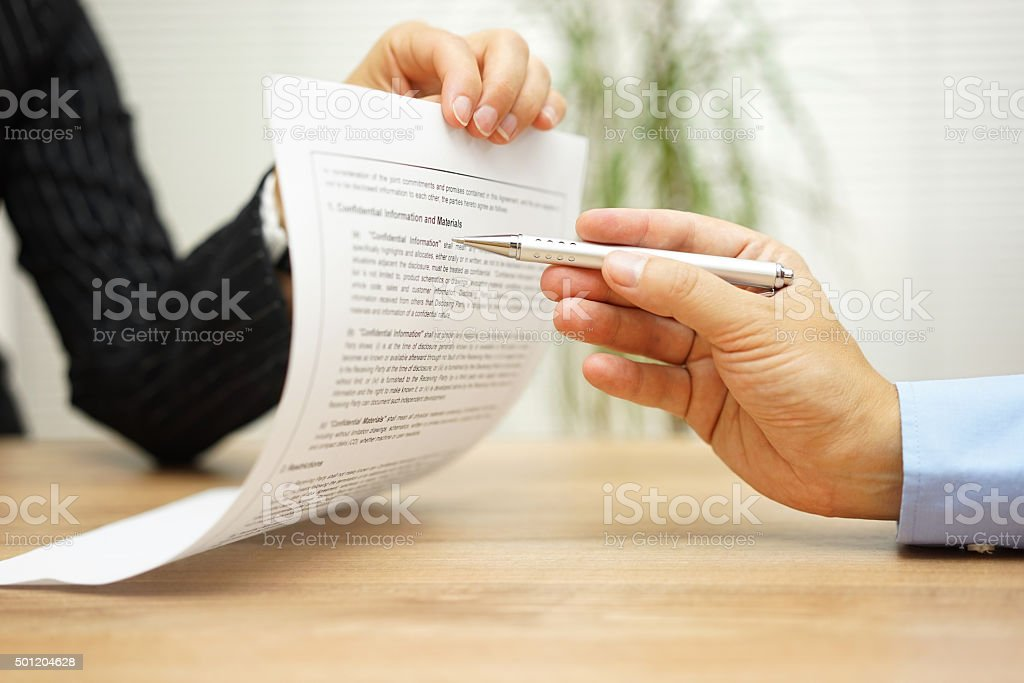 businesswoman holding legal document and  wants an explaination about article stock photo