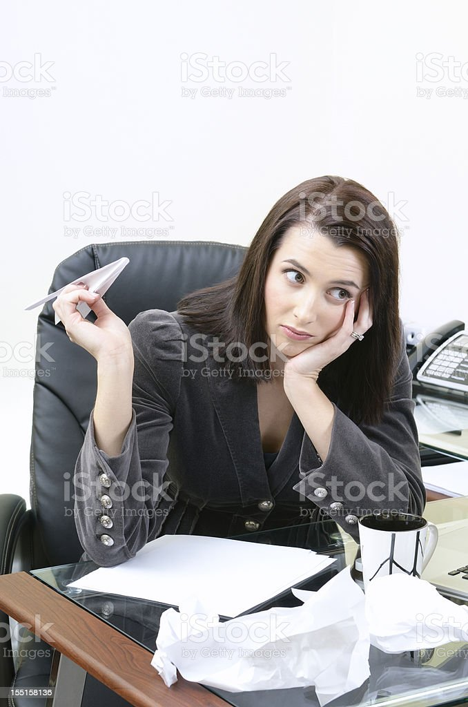 Businesswoman holding paper plane royalty-free stock photo