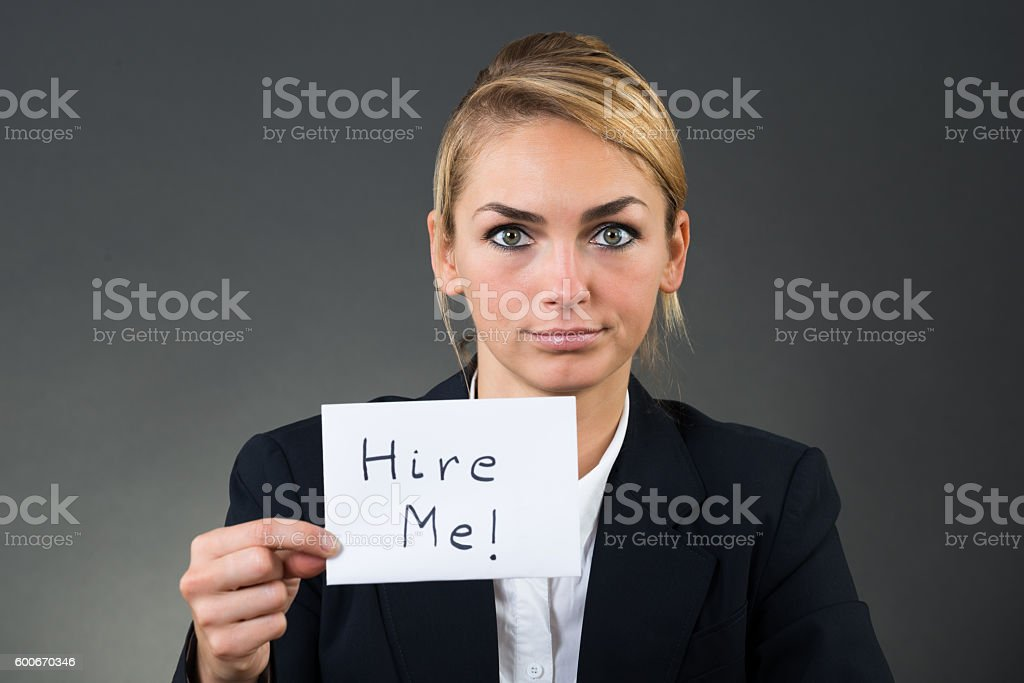 Businesswoman Holding Paper With Hire Me Text stock photo