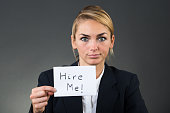 Businesswoman Holding Paper With Hire Me Text