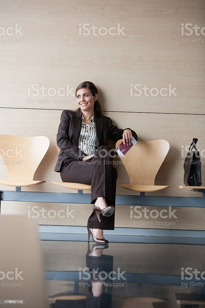 Businesswoman holding passport and airline ticket stock photo