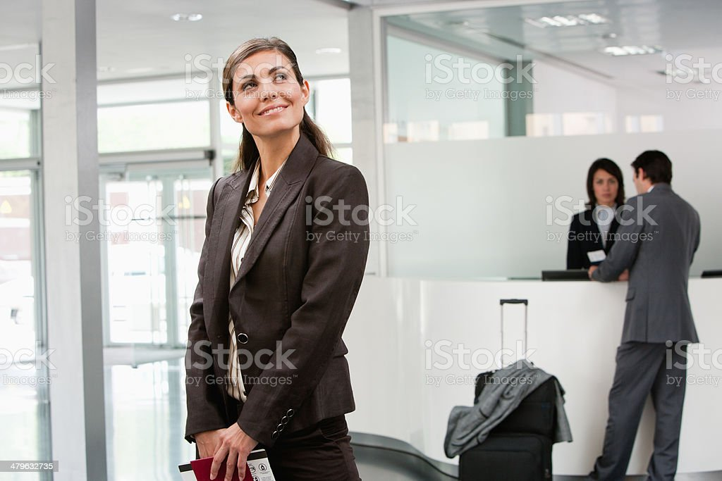 Businesswoman holding passport stock photo