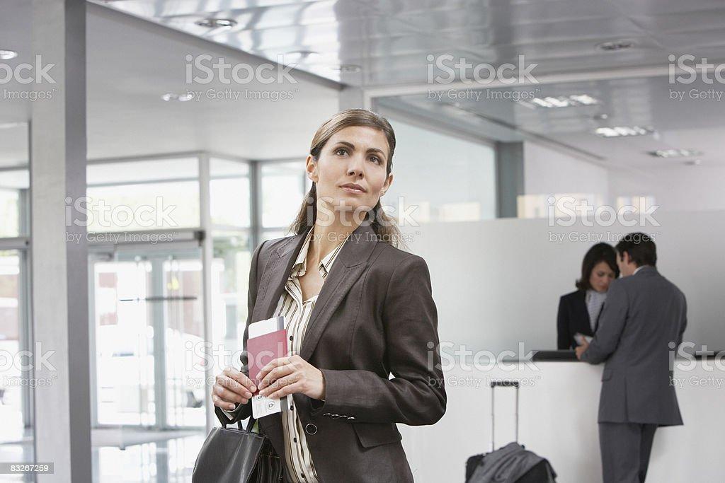 Businesswoman holding passport stock photo