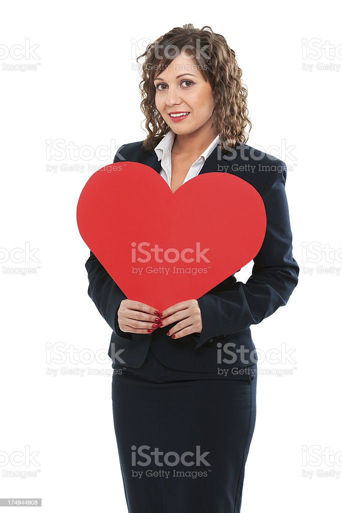 Businesswoman holding red paper heart royalty-free stock photo