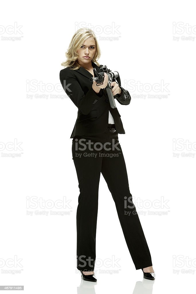 Businesswoman holding rifle stock photo